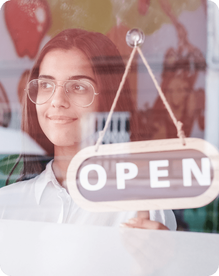 happy small business person changing closed to open