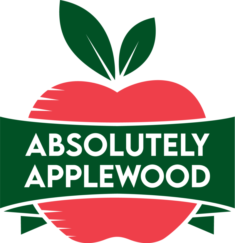 """Absolutely Applewood logo, a red apple with a banner across it that says """"Absolutely Applewood"""""""